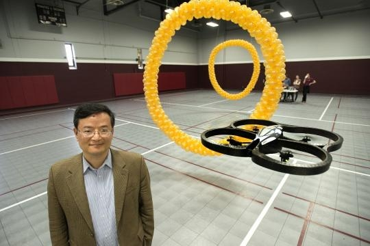 Professor Bin He in working on brain-controlled robots. (Photo via Phys.org)