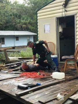 A Franklin County, Florida deputy arrests Kevin Wyatt on prostitution charges at a houseboat. Franklin County Sheriff's Office photo