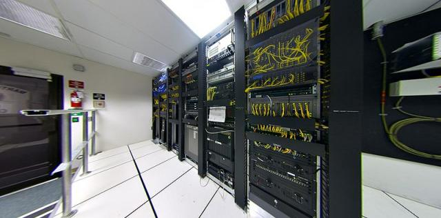 Telecommunications equipment in one corner of a small data center. - [Image Credit: Wikimedia Creative Commons]