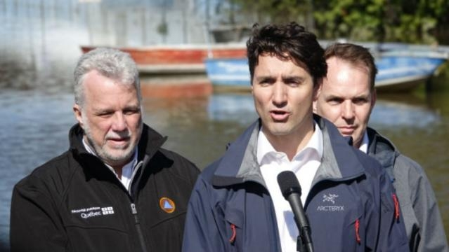 Prime Minister Justin Trudeau answers questions from reporters after touring the flooded areas of Gatineau, Que./ Photo via Giacomo Panico/CBC