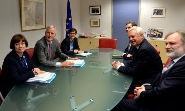 EU Chief Negotiator, Michael Barnier (L) and David Davis (R) inside the conference room.