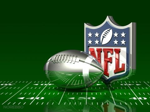 Silver Football and NFL Logo On Top of a Green Field - Image CCO Public Domain | Flickr | C_osett