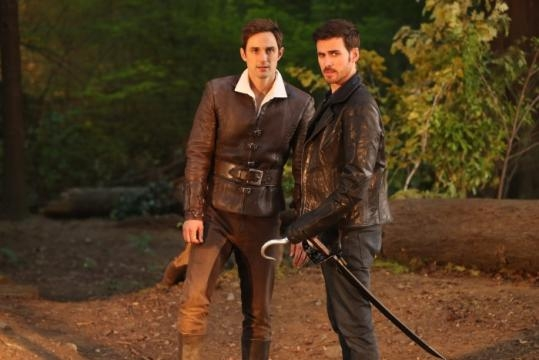 (L-R) Andrew J.West as Henry Mills and Colin O'Donoghue as Captain Hook/Officer Rogers (via eonline.com)