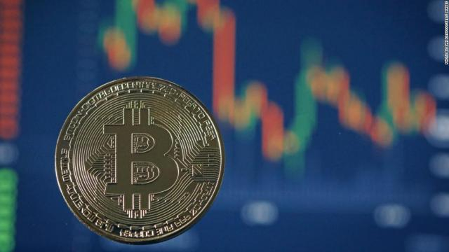 Bitcoin plunges more than $3,000 after hitting new record - Dec. 8 ... - cnn.com