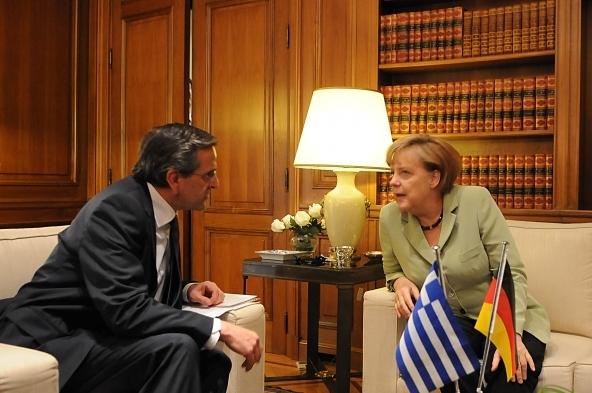 El primer ministro griego con la canciller alemana