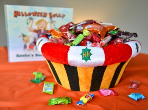 The book set includes a plush bowl where kids can save candy for Santa's elves. / Photo via Cara Via, used with permission.