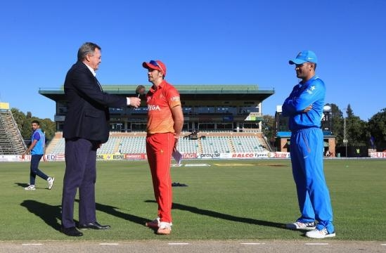 Dhoni at the toss with Zimbabwe skipper