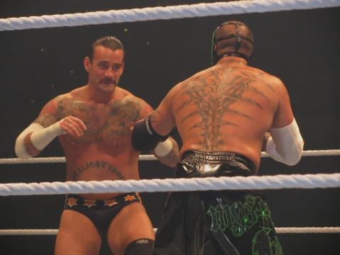 CM Punk vs. Rey Mysterio (photo via Flickr/Krystal Bogner)