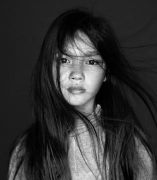 Lily Chee with her hair blowing. / Photo via Wendy Shepherd, Studio Matrix. Used with permission.