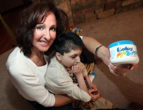 Majda Ficko and her son Demitri with the cream she invented for him. / Photos via Phil Hossack, the Winnipeg Free Press, and Olen Cosmetics.