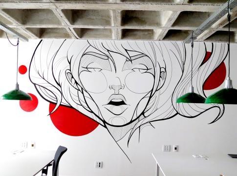 Decoração com wall painting no escritório de coworking (Divulgação).