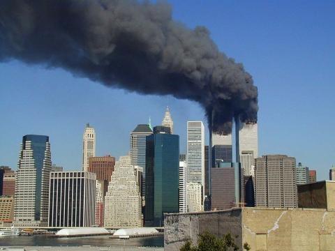 WTC smoking on 9-11 (Image Credit – Michael Foran – Wikimedia Commons)