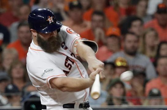 Evan Gattis como catcher o designado, será un arma secreta de los Astros en la Serie Mundial. Orange County Register.com.