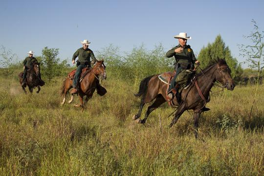 Border Patrol agents on horseback in South Texas. - [Image credit – Donna Burton, Wikimedia Commons]