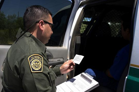 A Border Patrol agent at work. - [Image credit - Gerald L. Nino, Wikimedia Commons]
