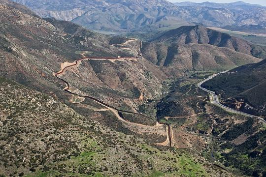 Aerial view of the border fence near San Diego (Image credit - Josh Denmark, Wikimedia Commons)