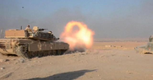 Iraqi troops firing on ISIS Mosul stronghold / Photo by CBSNews.com via Blasting News library