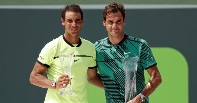 2017 Miami Open champion Roger Federer and runner-up Rafael Nadal pose with their trophies after the final in Miami on April 2, 2017.