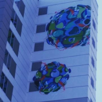 the world according to Abstrkt 100 feet high on the outside facade of the Pullman Hotel (Photo credit: Eric L. Labrador)