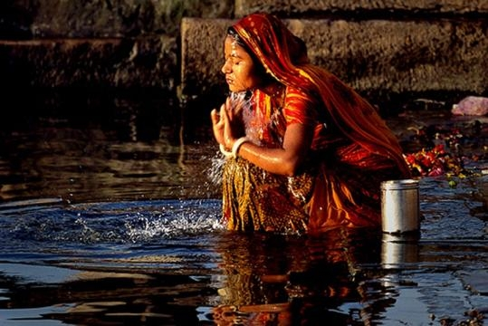 Indian woman in the river Ganges   World Tourism Place - worldtourismplace.com