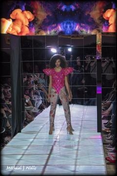 A model in a futuristic design walks the runway for George Styler at Scottsdale Fashion Week. (Photo copyright 2017 Michael J Wells)