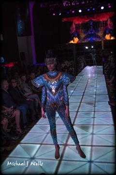 A model in a metallic blue design walks the runway for George Styler at Scottsdale Fashion Week. (Photo copyright 2017 Michael J Wells)