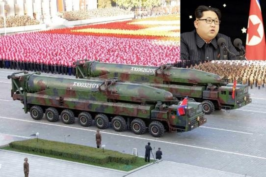 North Korea in a public showing of it's missiles, with President Kim Jong-un in the top left.