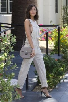 Olivia Culpo rocking a jumpsuit paired with metallic heels (Via: dailymail.co.uk)