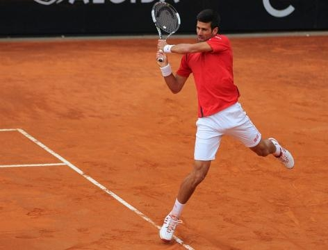 Novak Djokovic plays a backhand. Photo by Marianne Bevis -- CC BY-ND 2.0