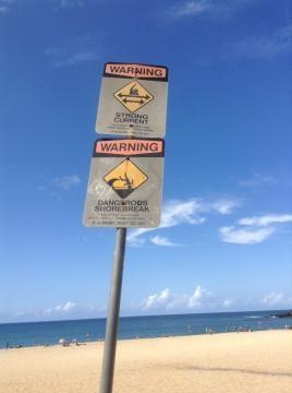 Warning sign for swimmers at Waimea Bay