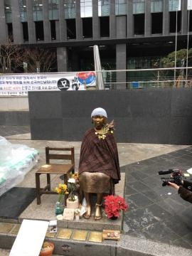 The statue symbolizing the Japanese military sexual slavery in front of the Japanese embassy in Seoul, South Korea. (source:Seungmock Oh)