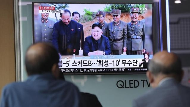 A picture depicting a jubulant Kim Jong-un promised more nuclear and missile tests - chicagotribune.com