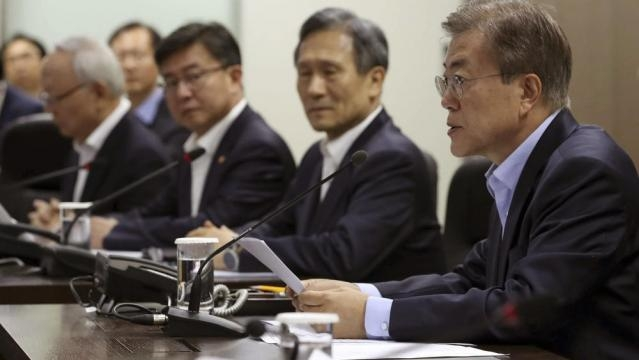South Korean President Moon Jae-in right in a meeting of the National Security Council - chicagotribune.com