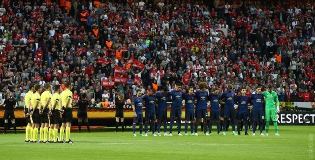 A moment of silence held before the start of the Europa Final. - facebook manchester united page