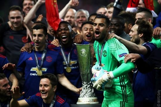 Manchester United holding the Europa Cup - facebook manchester united page