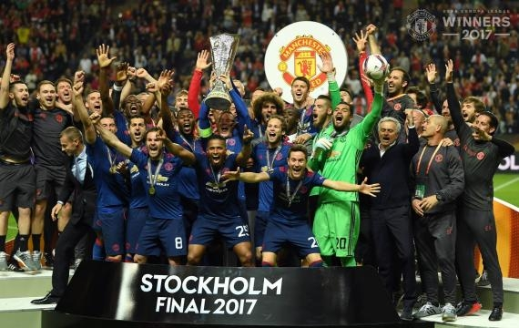 Red Devils players celebrating with the cup - facebook manchester united page