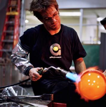 A photo of designer and artist Jamie Harris working in his studio. / Photo via Jamie Harris, used with permission.