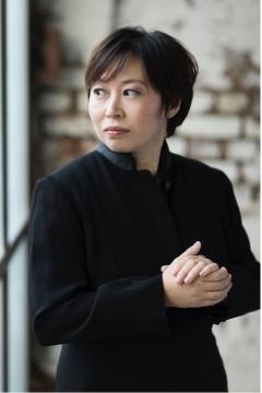 Xian Zhang in rare contemplative fashion; though always thinking, she's hardly ever still. Photo: Benjamín Ealovega, NJSO, used with permission.