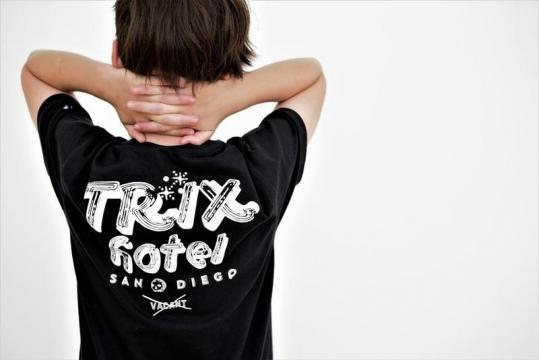 Dillan modelling the back of his t-shirt design. (c) Trix Clothing.