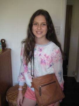 Sarah (12) models a Colorado leather handbag and Myer top