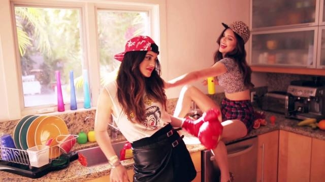 Kylie and Kendall Jenner pull out vintage t-shirts from their website. Photo via Steve Madden, YouTube.