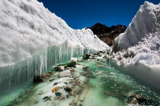 Glacial melt water carving the ice (credit – Sharada Prasad CS – wikimediacommons)
