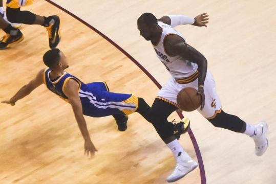 Steph Curry (left) and LeBron James during game 6 of the 2016 NBA Finals between the Warriors and Cavaliers - Erik Drost via Flickr