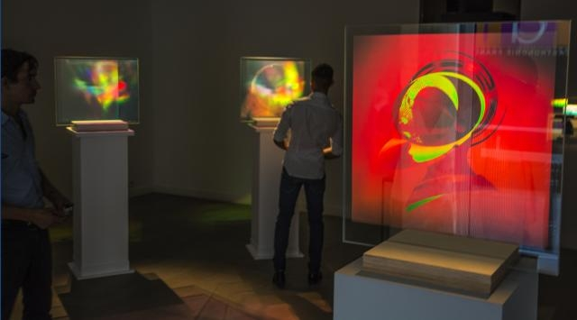 Holographic artwork is enjoyed by visitors to the HoloCenter. / Photo via Martina Mrongovius, HoloCenter, used with permission.