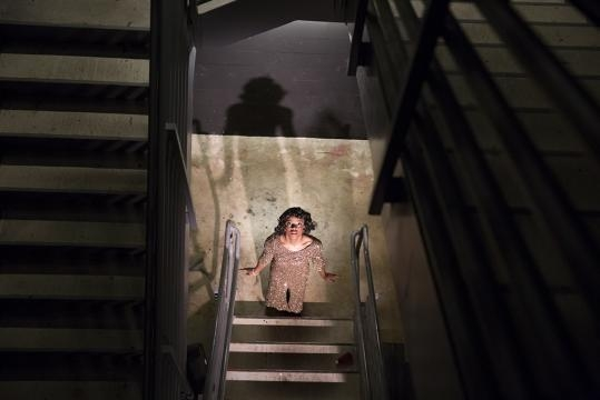 Guests watch certain segments of this immersive play from the stairwell. / Photo via Amanda Kaus and Third Rail Projects, used with permission.