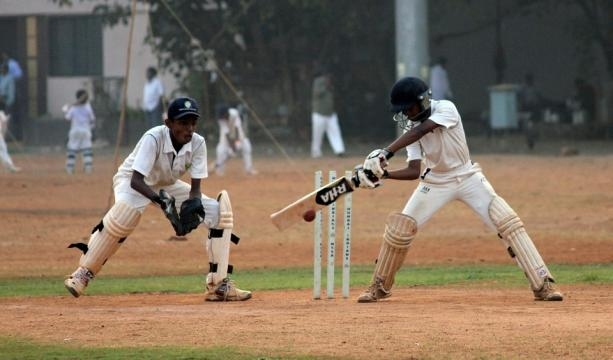Cricket is a very popular sport in India.Photo credit https://pixabay.com/en/wicketkeeper-cricket-batsman-390195/
