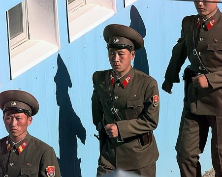North Korean soldiers are marching (credit - James Mossman – wikimediacommons)