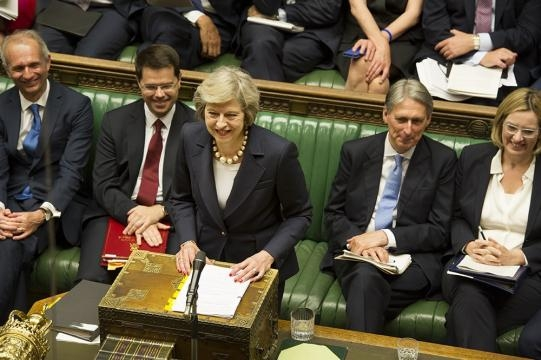 Theresa May exchanges a grin at leader of the Opposition Jeremy Corbyn - UK Parliament - Flickr