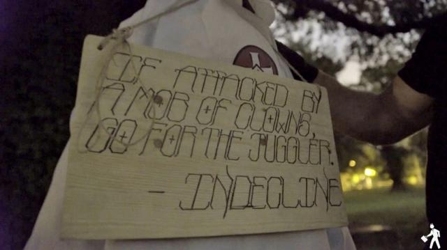 Art activist collective INDECLINE hung clown effigies dressed in KKK costumes in Bryan Park [Image: YouTube/INDECLINE]