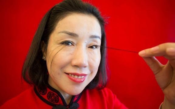 Le ciglia di You Jianxia sono le piùl unghe al mondo.